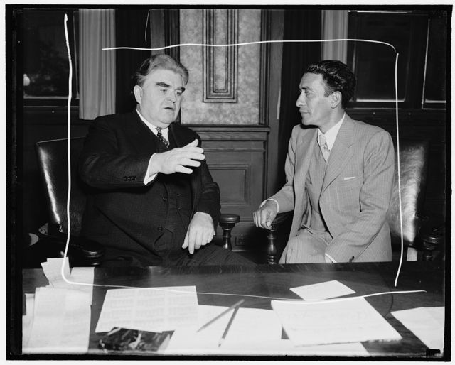 """Invites C.I.O. leader to the World Labor Conference in Mexico City. Washington, D.C., May 2. Vincente Lombardo Toledano, (left) Secretary General of the Confederation of Mexican Workers, today invited C.I.O. head John L. Lewis to attend a World Labor Conference against war in Mexico City next summer. Lewis said he would be """"pleased to attend"""". Toledano is enroute to Oslo, Norway, for a meeting of the International Federation of Trade Unions, 5/2/38"""