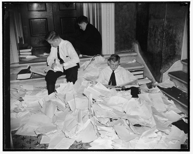 It won't be long now! Washington, D.C., May 19. Early adjournment of the Senate was forseen today by the number of bills being rapidly passed. Senate pages are pictured tearing from calender, bills that were passed yesterday, 5/19/38