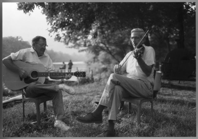 James Reed playing guitar, with Alan Jabbour playing fiddle, at a picnic along the New River, at Gentry Campground, off U.S. Highway 460, near Rich Creek, Virginia, September 1, 1996.