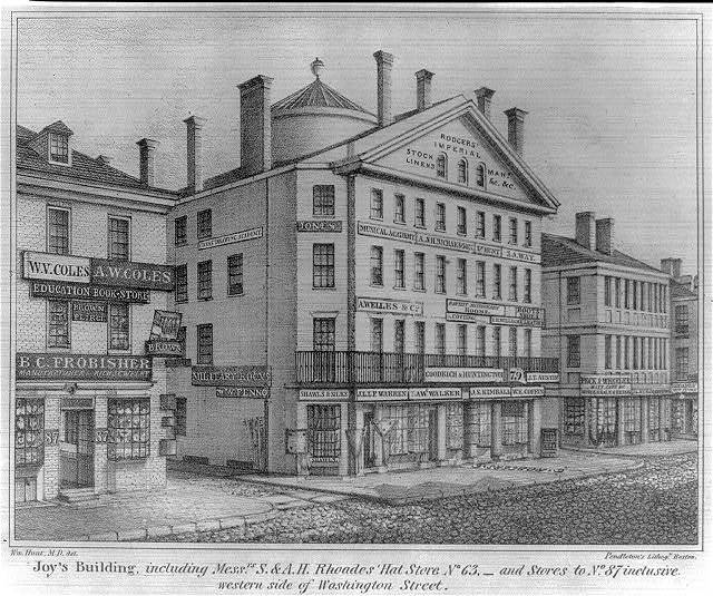 Joy's Building, including Mess. S.& A., H. Rhoades' Hat Store no. 63, and stores to no. 87 inclusive, western side of Washington Street