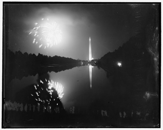 July 4 fireworks over Washington Monument. Washington, D.C., July 5. Washington's annual display of pyrotechnics took place last night on the grounds surrounding the Washington Monument. This is a view taken from in front of the Lincoln Memorial, showing the monument and bursting rockets reflected in the reflection pool before the Lincoln Memorial