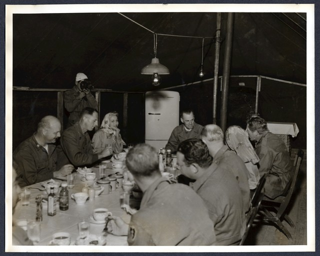 K aye gossips with Maj. Gen. Ira P. Swift, commander of the 25th division, during lunch held at division command post.