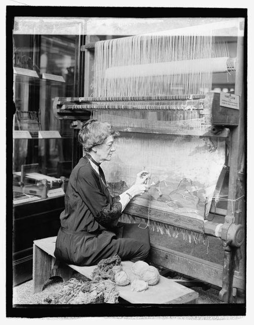 Katherine P. Crawford with Danish loom at museum, 5/7/26