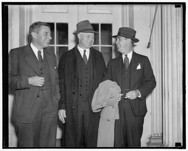 Labor Board reports to the President Washington, D.C., Nov. 2. Chairman Warren Madden, of the NLRB shown with other members of the Board after they reported to the President today at the White House. Madden said after the conference with the President that members of the Board for not believe that the Wagner Act needs revision. Madden, also advised the President of the Boards stand against amendment of revision, left to right. E.W. Smith, Madden, and Donald Wakefield Smith, 11/2/38