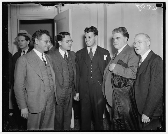 Labor strategists confer with heads. Washington, D.C., Jan. 12/37. In a meeting of labor leaders concerned in the automobile strike against General Motors Corporation, the charges that General Motors were hiring professional strikebreakers in an attempt to put an end to it was made. Homer L. Martin stated that the United Automobile Workers would end the strike if they were given collective bargaining. In the picture, from the left are: Sidney Hillman, member of the CIO; Homer L. Martin, President of the U.A.W.; Leo Pressman, CIO General Counsel; John L. Lewis, President of the United Mine Workers; and John Brophy, Director of the CIO