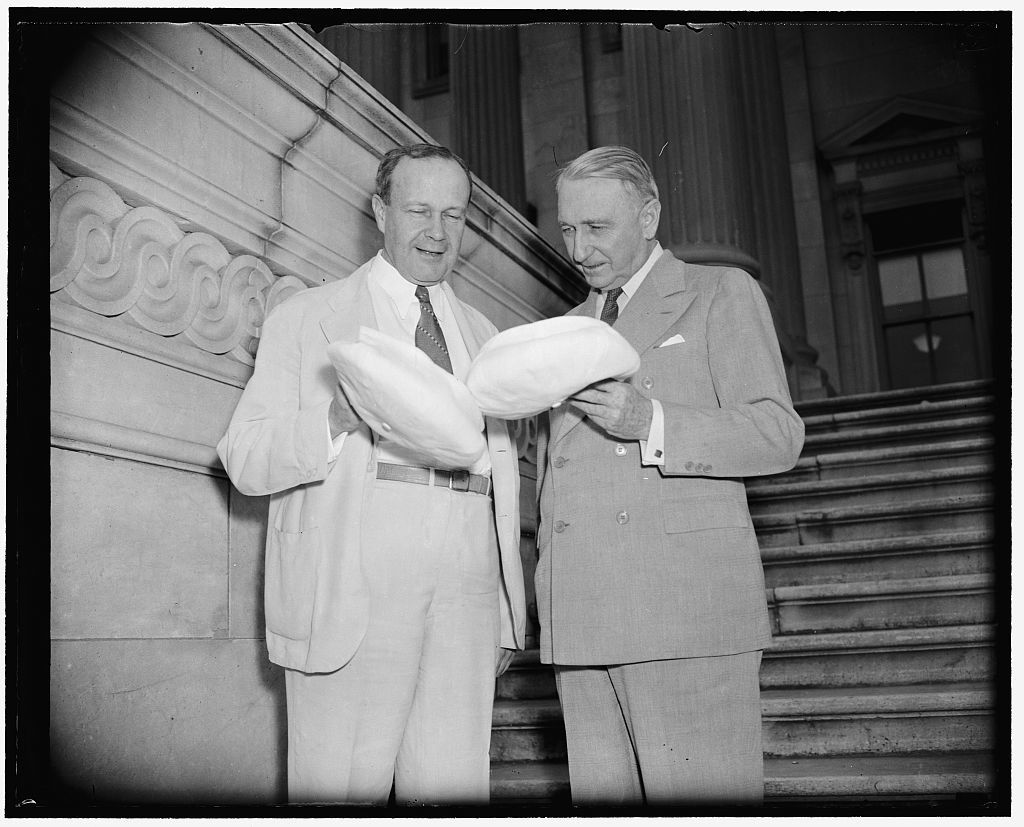 Largest and smallest heads in Senate. Washington, D.C., June 15. A gift of light summer caps for the home going Senators today disclosed that Senator Robert J. Bulkley, Ohio, wearing a size 73/4 has the largest head in the Senate; and Senator Walter F. George, (right) the smallest with a cap size of 63/4 being a perfect fit, 6/15/38