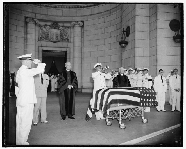 Last honors paid Navy Secretary at Union Station as bugler blows taps. Washington, D.C., July 10. While Senate Chaplain, the Rev. Ze Barney Phillips, stood on the bugler's right and the Rev. James Shera Montgomery, Chaplain of the House stood on the left, a navy bugler blew taps over the casket of Navy Secretary Swanson when the body arrived on a gun caisson at Union Station for entrainment to Richmond for the funeral