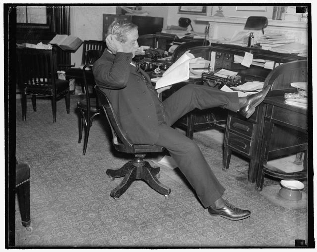 "Last study of farm bill. Washington, D.C. Senator Ellison D. ""Cotton Ed"" Smith, Chairman of the Senate Agriculture Committee, makes a last- minute study of the newly drafted Farm Bill before introducing it on the floor of the Senate today. 11/22/37"