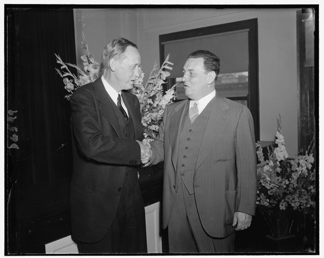 Leon Henderson shortly after being sworn in as member of Securities & Exchange Commission. Being congratulated by Harry Hopkins, Secy. of Commerce