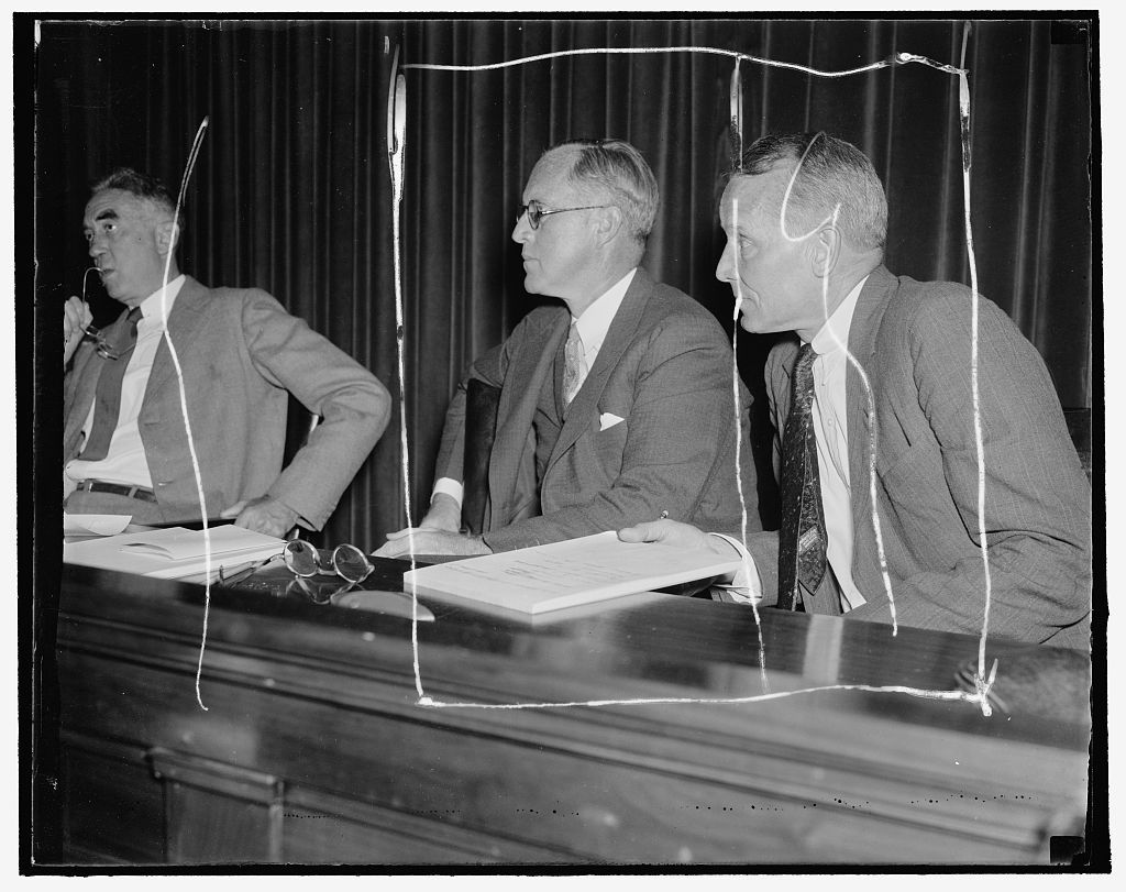 Listen to maritime troubles. Washington, D.C. Aug. 23. Chairman Joseph P. Kennedy, (left) and Commissioner Emory S. Land listen intently as maritime labor chiefs testify at the initial hearing of the U.S. Maritime Commission today in efforts to determine methods to avoid costly industrial labor disputes which have hampered the American Merchant Marine. 8/23/37