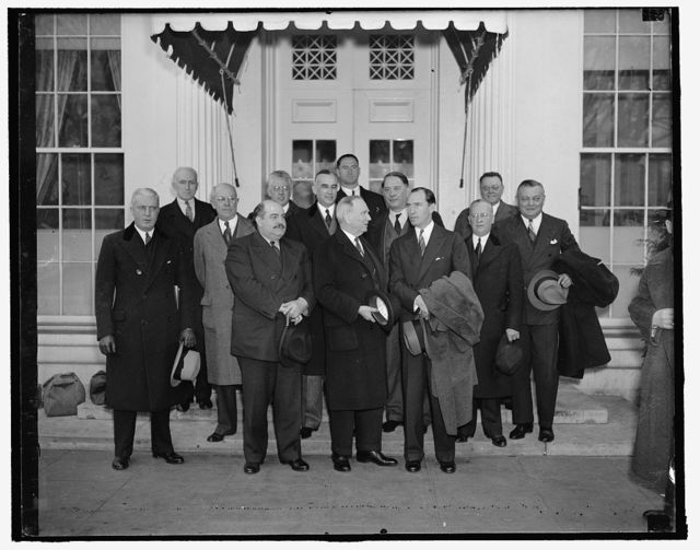 Little business men meet the President. Washington, D.C., Feb. 4. President Roosevelt today met in what was described as constructive discuss on with small business leaders. He was reported to believe that some of their recommendations could be carried into effect, shown as they left the White House after the conference. Left to right, front: R.P. Hastey, Chicago; O.L. Roach, Danville, VA.; Leslie E. Sanders, Orlando, Fla.; Secretary of Commerce Daniel Roper; Bernard F. McLain, Dallas, Tex.; Howard D. North, Cleveland; Wallace D. Kimball, New York City. In the rear, left to right: D.E. McAvoy, New York City; Joseph D. Kleckner, Chicago; Asst. Sec. of Commerce Ernest Draper; W.C. Tinsley, Tampa, Fla.; James Daly, Columbus, OH; W.K. Gunter, Gaffney, N.C., 2/4/38