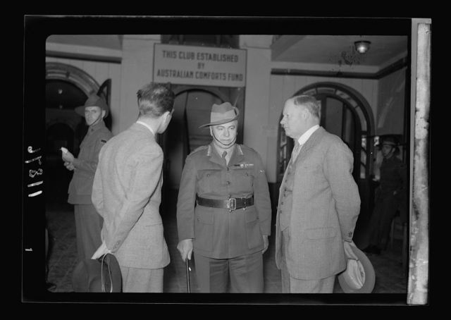 Lt. Gen. Blamey, Mr. Keith Roach & Mr. Riddle, private sect'y [i.e., secretary] in hall way of Aussi [i.e., Australian] soldiers' clu[b]