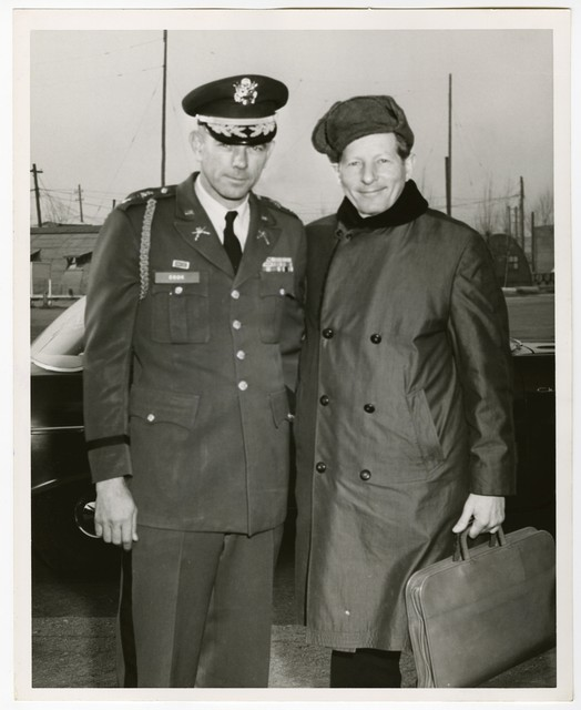 Maj Sidney H Cook, Jr, 31st Inf Div, Camp Casey, poses with Singer, Star Danny Kaye before his departure from a whirlwind tour of the ROK