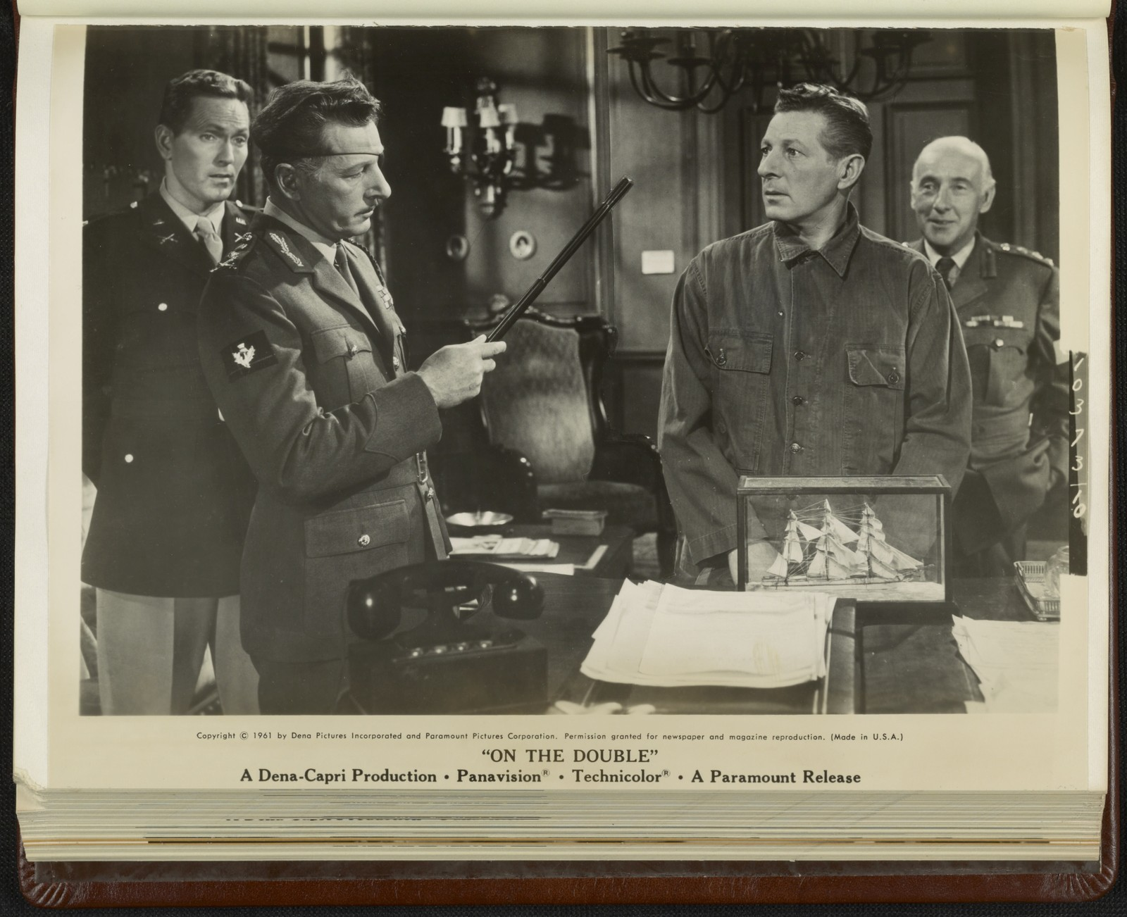 """[ Major Houston (Gregory Walcott), General MacKenzie (Danny Kaye), Ernie Williams (Danny Kaye), and Colonel Somerset (Wilfrid Hyde-White) in a scene from """"On the Double""""]"""
