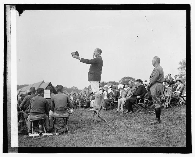 [Man standing on chair speaking at outdoor gathering], 7/2/22