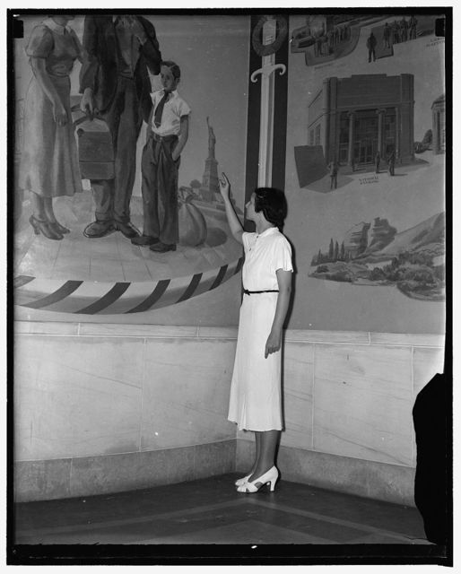 Many errors found in Department of Justice mural. Washington, D.C., Aug. 17. Aides of Attorney General Cummings are taking great delight these days in criticizing the realism of several of the murals which [...] Boughe[?], New York artist painted for the new Department of Justice building. Miss Margaret Burgess, a sightseer, points to the Statue of Liberty which was painted facing shoreward instead of seaward other glaring errors showed a convict facing four members of the Federal Court of Parole, although actually he faces only one in real life, a fire starting in a large city, although Federal Investigators work only on arson cases on Indian Reservations, 8/17/37