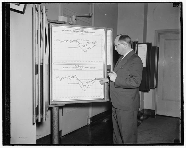 Map depicts significant story on pickup in American industry. Washington, D.C. March 30. Tow lines on this chart hanging in the office of Isador Lubin, Commissioner of Labor Statistics, U.S. Department of Labor, tell a significant story of the pickup in American Industry since 1933. Mr. Lubin points to line no. 1 which represents the consumers or nondurable goods industries (food, clothing, etc.) it began to climb in 1933 and has been on the upgrade ever since. Line no. 2 represents durable goods or heavy industry (steel building materials, machinery). It was hardest hit by the depression, lagged far behind even during most of 1936. But line no. 2 is going almost straight up. By March 1, it has attained a level almost parallel with consumers goods. This means that for the first time since 1929, payrolls in vital heavy industries are once again in a normal relation to payrolls in the consumer industries.