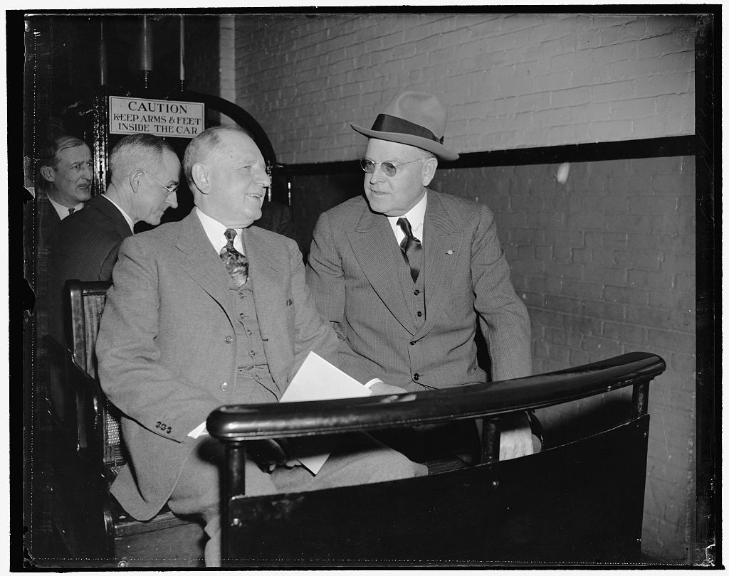 Maybe the Jackson Day dinner invitation. Washington, D.C., Jan. 3. They could be discussing the invitation Senator Warren R. Austin, right, Republican of Vermont and Senate Minority Leader, received for the Jackson Day dinner. At any rate, Senator George L. Radcliff, left, and Senator Austin seem to be enjoying the ride on the Senate subway to the Capitol today for the opening session