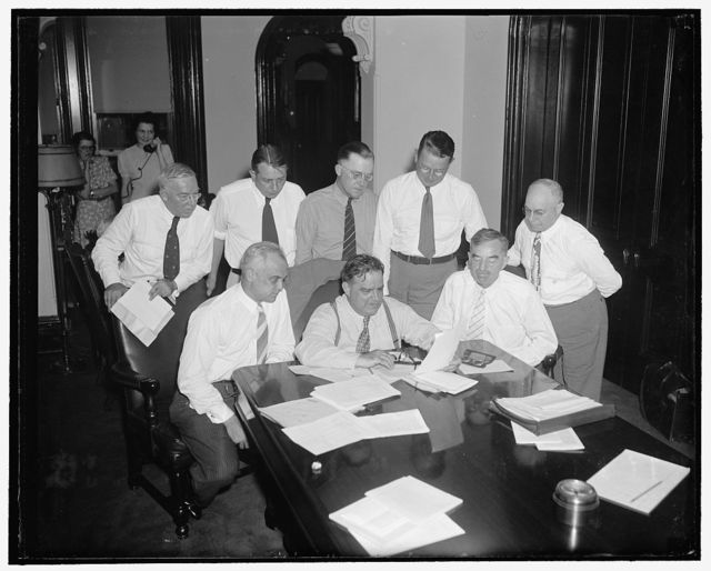 Mayors discuss WPA strike situation in special session. Washington, D.C., July 14. At an extraordinary session called this morning by their president, Mayor Fiorello La Guardia, the Executive Committee of the U.S. Conference of Mayors surveyed the entire strike of WPA employees throughout the country. At the conclusion of the meeting, Mayor LaGuardia announced that the Executive Committee would confer immediately with Commissioner Harrington on the strike situation. Front row, left to right: Harold H. Burton, Mayor of Cleveland, Ohio; Mayor LaGuardia of New York City; Daniel W. Hoan, Mayor of Milwaukee, Wisconsin. Back row, left to right: C.D. Scully, Mayor of Pittsburgh, Pa.; Paul V. Betters, Mayor of Amarillo, Texas; Joseph D. Scholtz, Mayor of Louisville, Ky.; and Richard W. Reading, Mayor of Detroit, Mich.