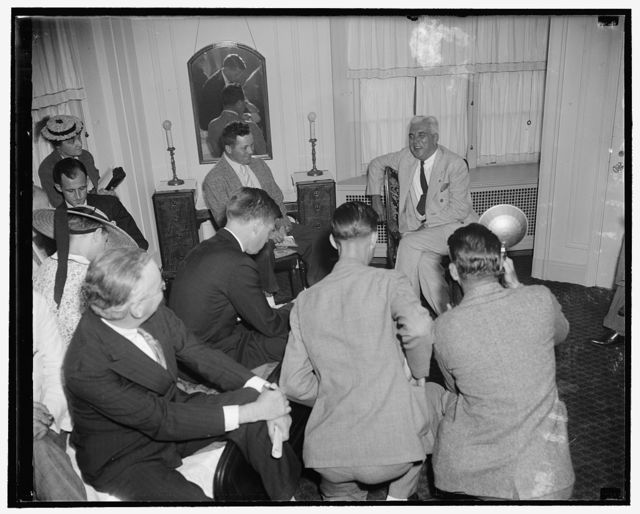 McNutt faces cameramen and reporters at press conference. Washington, D.C., July 6. Paul McNutt, Governor General of the Philippines and announced candidate for the democratic presidential nomination in 1940 in the event President Roosevelt does not run, faces a battery of cameramen and a corps of newsmen at a press conference shortly after his arrival in the Capital today