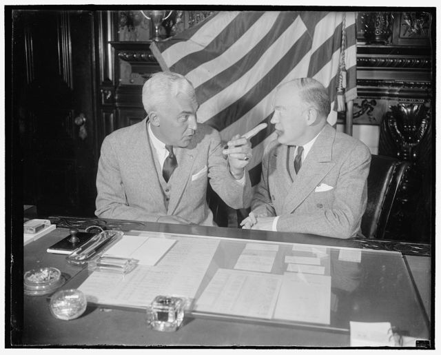 McNutt talks, Woodring listens. Washington, D.C., Feb. 23. Paul V. McNutt, High Commissioner to the Philippines who arrived in Washington today to make an official report, conferred at length with Secretary of War Harry H. Woodring this morning. Following the meeting both declined to comment on the transfer of Lt. Col. Davenport Johnson from Hamilton Field, Calif., to Chanute Field, Ill. Johnson is the flyer who piloted McNutt and his administrative assistant from San Francisco to Denver in an Army plane. Soon after Johnson's transfer to Chanute Field, known to the Air Corps as the Siberia of the Army, was announced, 2/23/38