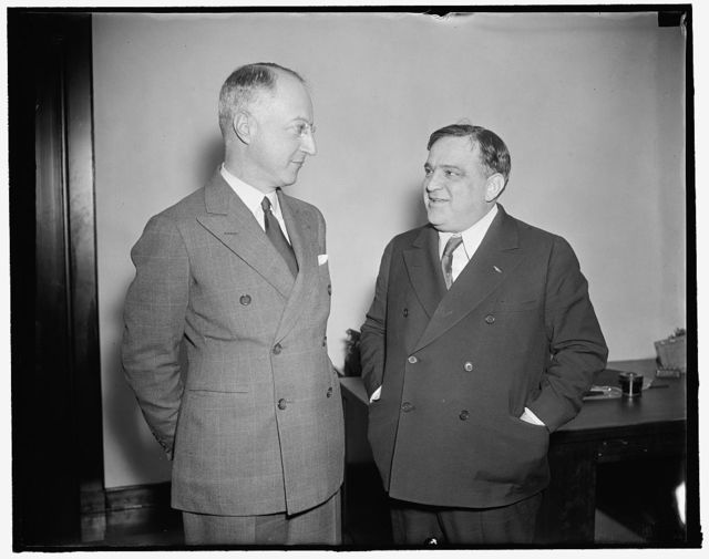 "Meeting of New York's mayor and housing administrator ends in love feast. Washington, D.C., Dec. 11. What promised to be a red-hot meeting between U.S. Housing Administrator Nathan Straus (left) and New York Mayor Fiorella La Guardia took the form of a love feast before the confab ended. Straus said he had always considered Mayor La Guardia the best New York had had in his memory. While he noted New York's Housing Authority was starting two weeks late because it had not sent representatives to exploratory conferences, Administrator Straus promised La Guardia that they would receive the ""same prompt consideration"" of low cost housing project as any other community. 12/1/37"