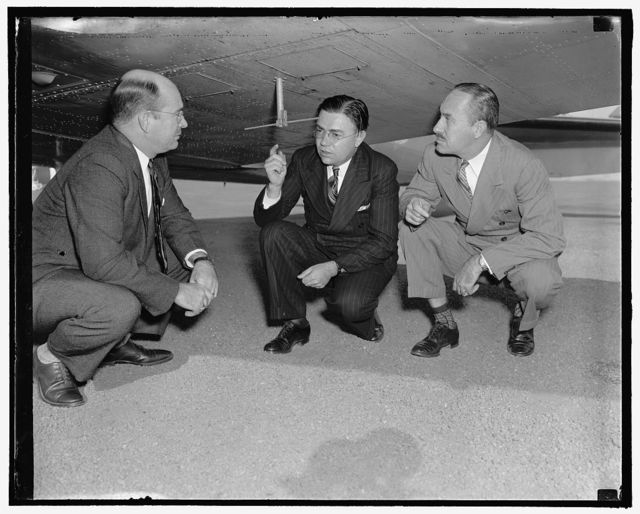 Members of Civil Aeronautics Authority inspect latest aid to airplane pilots. Washington, D.C., Oct. 10. An instrument which gives airplane pilots their height above the ground over which the plane is flying was demonstrated today to members of the Civil Aeronautics Authority by officials of the Western Electric Co. and the United Airlines. Claimed to be the first successful altimeter showing terrain clearance, the new device operates by radio, using the shortest wave ever employed for aviation, officials of the companies stated. In the photograph, left to right: Col. Sumter Smith, Peter C. Sandrette, Supt. of the United Airline's communication laboratory who was in charge of the demonstration; and Thomas Hardin. Smith and Hardin are members of the Civil Aeronautics Authority, 10/10/38
