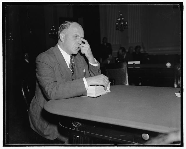 """Michigan State cop testifies before the Dies Committee. Washington, D.C., Oct. 22. Lt. Harold Mulber, of the Michigan State Police Force, who told the Dies Committee Investigating Un-American Activities about the """"Labor Holiday"""" held in Lansing, Mich. Last year when police arrested eight pickets, 10/22/38"""