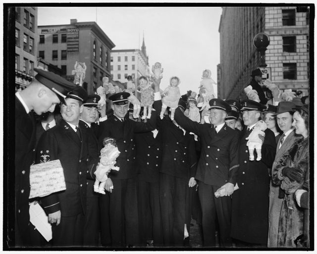 Midshipmen donate dolls for poor kiddies of Capitol. Washington D.C., Dec 22.. Hundreds of midshipmen from Annapolis enroute to their homes for the holidays arrived in Washington today, their arms loaded with dolls for the poor kiddies of the city. The dolls were dontated to the doll house in the center of the city from where they will be distributed to unfortunate youngsters on Christmas Day. 12/22/37