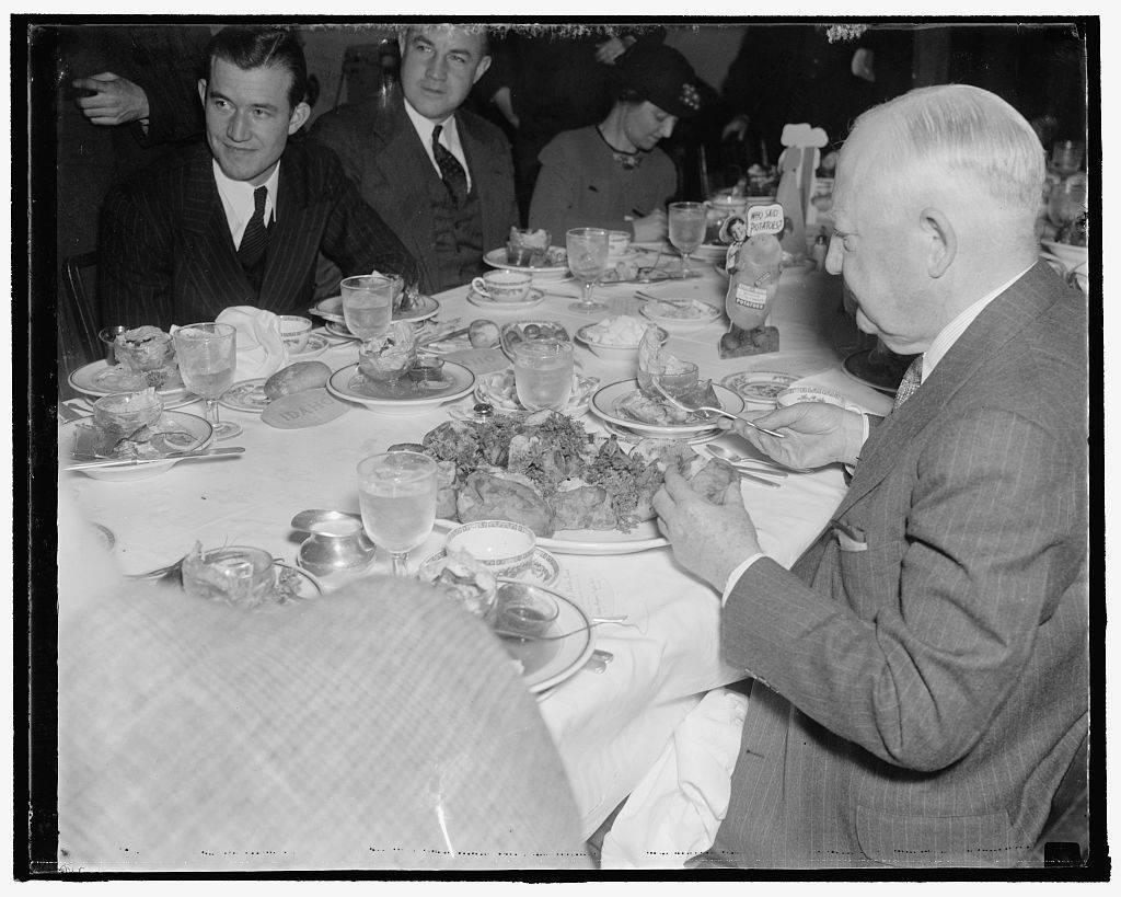 Minority leader relishes spuds. Washington, D.C., Dec. 8. House Minority Leader Bertrand Snell of New York, seemed to relish the spuds from both states as he participated in potato eating contest today in the House Restaurant to determine which state grows the best potatoes - Idaho or Maine. The controversy started when a carload of potatoes from Idaho was sent to the Capitol for distribution to the members of Congress. 12/8/37