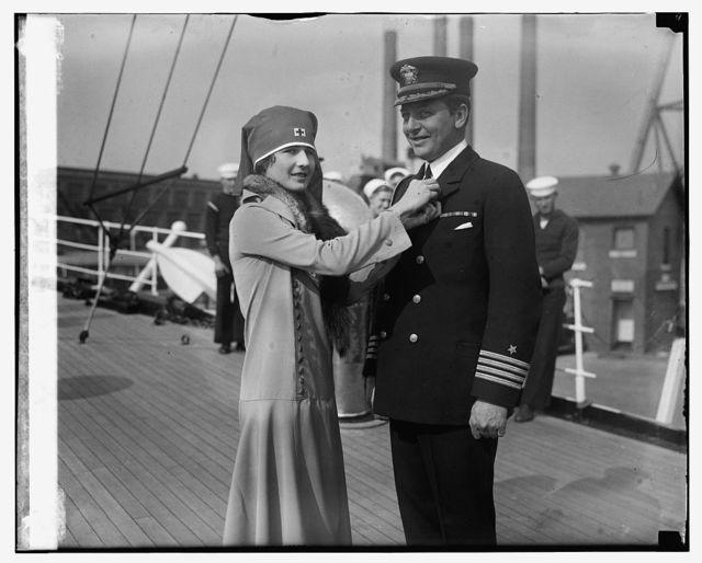 Miss Virginia Hitt pinning cross button on Capt. A.A. Andrews, 11/5/24