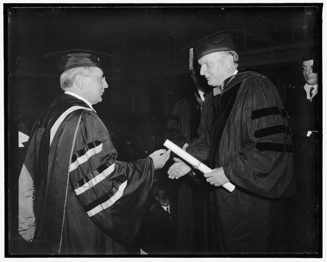 Montana receives honorary degree from American University. Washington, D.C., June 7. An honorary degree was conferred on Democratic anti-New Deal Senator Burton K. Wheeler, of Montana, by American University tonight. Dr. Joseph M. Gray, (left) Chancellor of the University is pictured conferring the honor on the Senator.