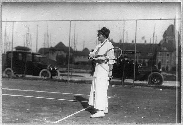 Mrs. T. Cassebeer [holding tennis racket on court]
