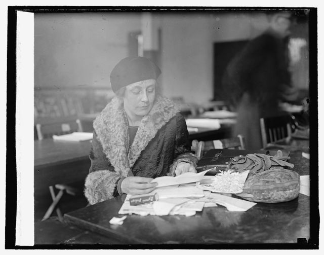 Mrs. William Mitchell opening mail for the Colonel, 10/30/25