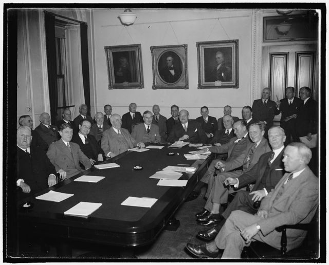 National Defense Power Committee meets. Washington, D.C., Oct. 28. The National Defense Power Committee, created by the president on Sept. 3 to study the problems of electrical power as related to national defense, met at the War Department today. The Committee announced definite commitments on the part of leading utility companies in the nation's strategic war materials centers to place immediate orders for turbo-generators, boilers, and auxiliary equipment totalling 1,000,000 kilowatts of generating capacity. Reading from right to left around the table are - Elbert K. Burlew, C.E.E. Grossbeck, William Douglas, Floyd L. Carlisle, Basil Manley, Assistant Secretary of War Louis Johnson, Assistant Secretary of Navy Charles Edison, Fred. A. Delano, Benjamin V. Cohen, James F. Fogarty