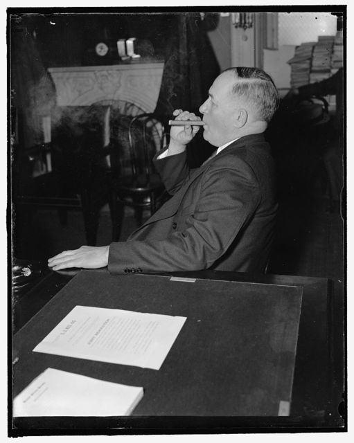Nebraska Senator. Washington, D.C., Feb. 1. Senator Edward R. Burke of Nebraska, who recently introduced bill for a senate investigation of the National Labor Relations Board, listens in at the Senate hearing on the nomination of Robert H. Jackson to be Solicitor General, 2/1/38