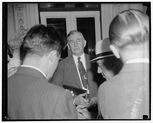 Nesmen question Senate majority leader as he leaves the White House. Washington, D.C., July 17. Emerging from a White House conference with President Roosevelt today, Senate majority leader Alben Barkley announced to reporters that 'no decision had been reached' on the next move in the congressional deadlock over neutrality legislation. He indicated that he might try to keep Congress in session until action on neutrality legislation has been obtained
