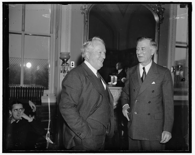 Nevada's Senators. Washington D.C. Senator Pat McCarran and Senator Key Pittman, (right) both Democrats from Nevada, exchanging opinions on President Roosevelt's proposal that the membership of the Supreme Court be increased to possibly 15 members. They are pictured as they attended a meeting of the Senate Judiciary Committee today