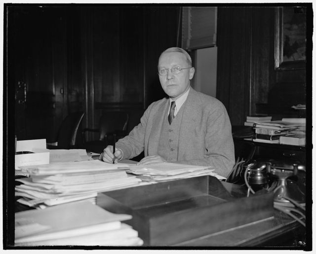 New Assistant Secretary of Interior. Washington, D.C., April 9. Ebert Burlew, new First Assistant Secretary of Interior, photographed at his desk shortly after taking the oath of office yesterday. He succeeds the late Theodore A. Walters, 4/9/38