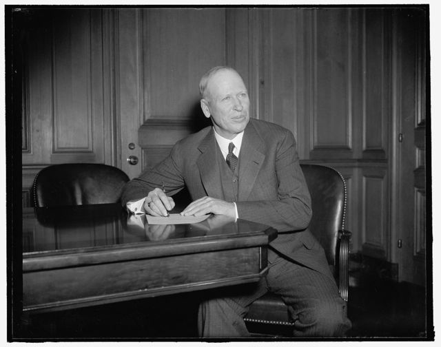 New Assistant Secretary of Labor. Washington, D.C., Jan. 20. Charles V. McLaughlin, new Assistant Secretary of Labor, photographed at his desk today shortly after he took the oath of office. McLaughlin, who is Senior Vice President of the Brotherhood of Firemen and Enginemen, succeeds Edward F. McGrady now with RCA, 1/20/38
