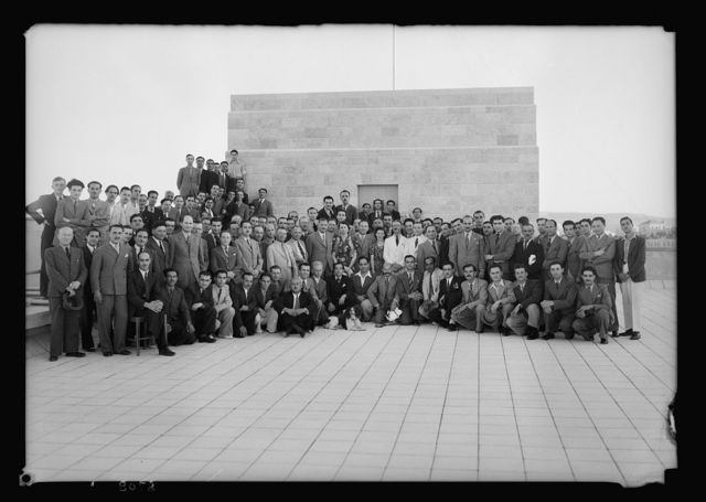 New broadcasting studios on Queen Milisande's Way, Jerusalem. Engineering staff & workers on roof of Gen. P.O. bldg. [i.e., General Post Office Building], June 28, '38 on occasion of Mr. Brasher's farewell