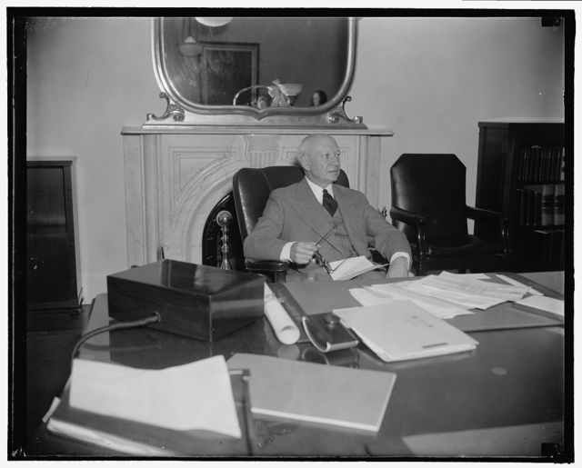 New Comptroller of the currency. Washington, D.C., Oct. 24. Preston Delano, newly named Comptroller of the Currency to succeed J.F.T. O'Connor, photographed at his desk today shortly after taking the oath of office, 10/24/38