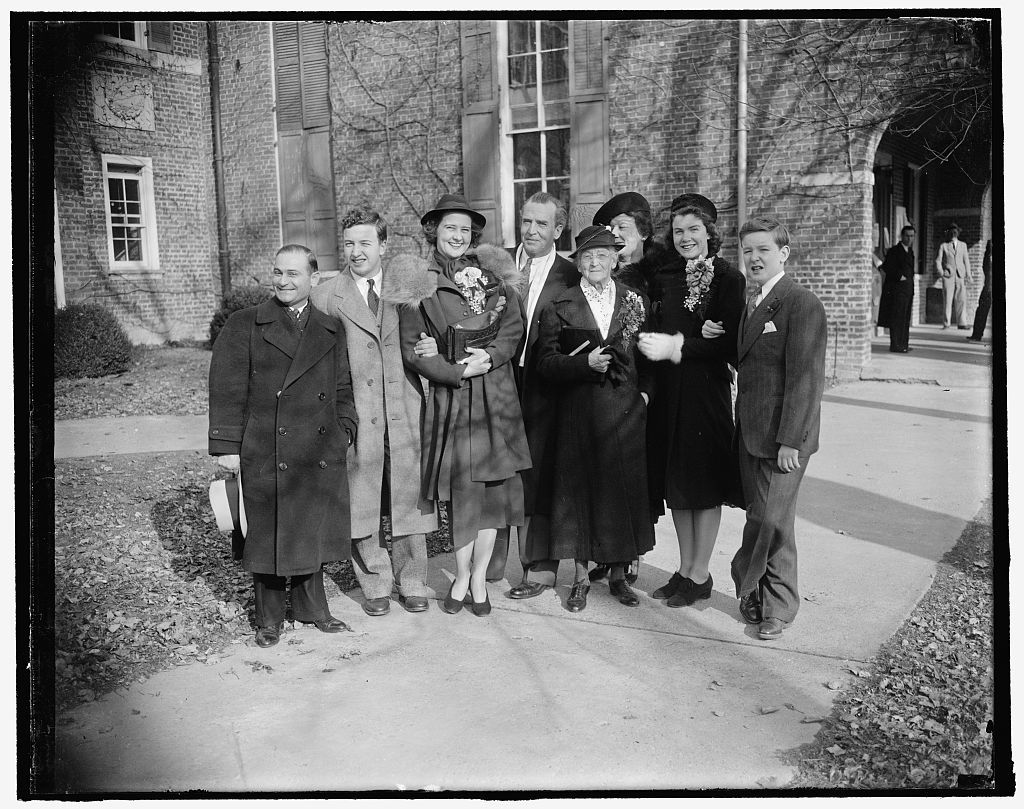 New Jersey senator weds in Virginia. Fairfax Courthouse, Va. Feb. 9. United States Senator William H. Smathers of New Jersey, with his bride the former Mary James Foley of Berryville, Va., are shown with a group of relatives and friends who witnessed the ceremony today in the historic courthouse here. In the photograph, left to right: Fred Yale of New Jersey; Joseph B. Smathers, son of the Senator by a previous marriage; Mrs. Smathers, the bride; Senator Smathers; Mrs. B.F. Smathers, the Senator's Mother; Mrs. William Abbott Coleman of Arlington, Va., Aunt of the Bride; Miss Billie Smathers, daughter of the Senator; and Benjamin F. Smathers, another son, 2/9/38