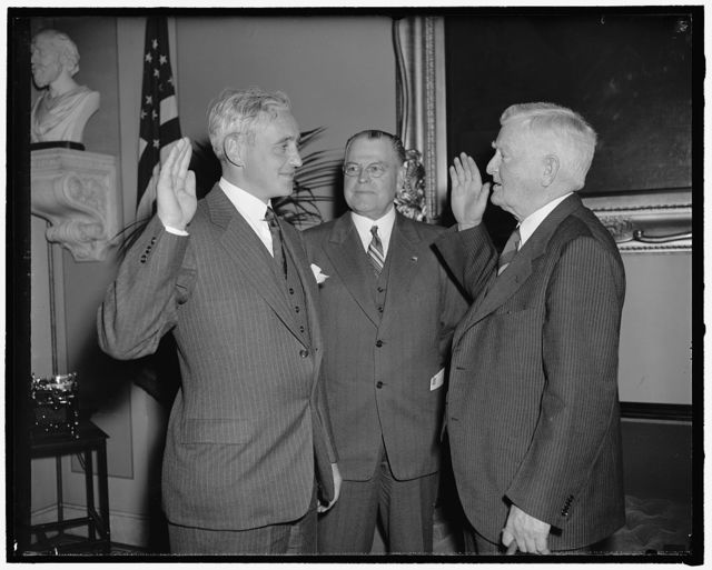 New Republican Senator from Vermont takes oath. Washington, D.C., July 1. Senator Ernest W. Gibson, Jr., was today sworn in as a Republican member of the upper house of Congress to fill the unexpired term of his father the late Senator Ernest W. Gibson. Left to right: Senator Ernest W. Gibson, Jr., Vice President Garner, and Senator Warren R. Austin, senior senator from Vermont, 7-1-40