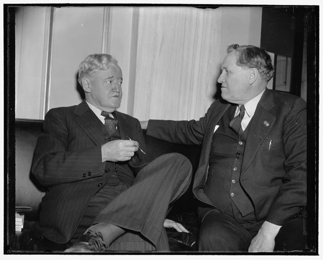 New Senator meets old timer. Washington, D.C., Dec. 28. Senator Clyde M. Reed, Republican elect from Kansas, after a press conference and session with photographers, found time to have some words with ex-Senator Smith W. Brookhart, Republican from Iowa who served from 1923-33, 12/28/38