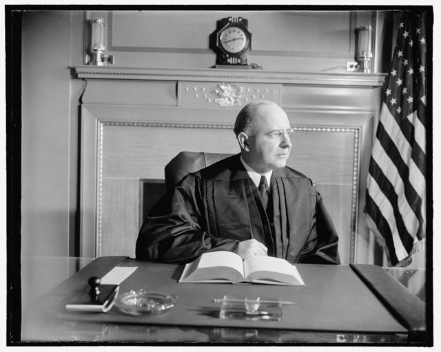 New Supreme Court Justice in robes. Washington, D.C., Jan. 29. The new Associate Justice of the United States Supreme Court, Stanley Reed, pictured in his robes for the first time since his confirmation. Warning to editors: