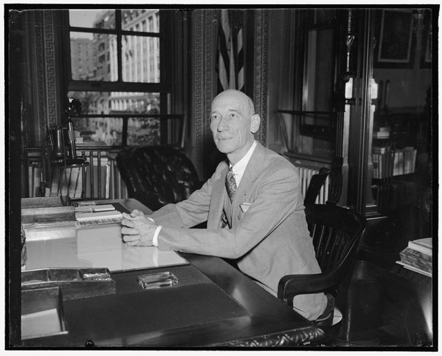 New U.S. Adjutant General. Washington, D.C., May 2. Major General Emory S. Adams was today sworn in as Adjutant General, Army to succeed Maj. Gen. Edgar T. Conley pictured at his desk on the first day in new post, 5/2/38