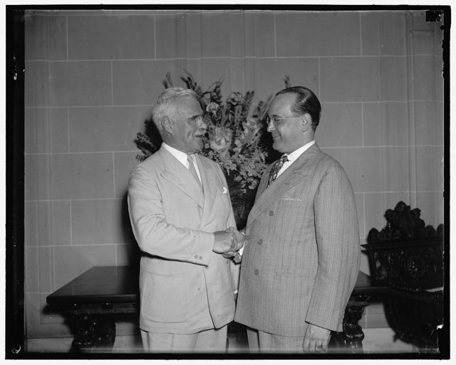 New U.S. envoy to Cuba guest of Cuban Ambassador. Washington D.C., July 15. J. Butler Wright, new U.S. Ambassador to Cuba, is greeted by Senor Dr. Pedro Martinez Fraga, Cuban Ambassador, as he arrived at the Cuban Embassy where he was guest at luncheon today, 7/15/37