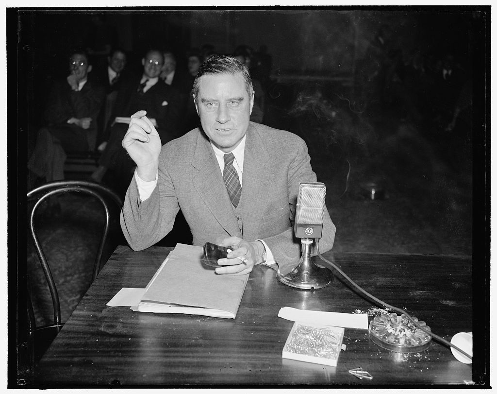 NLRB Invesitgating Committee quizzes Edwin Smith?, NLRB Board member. Washington, D.C., Dec. 15. Edwin S. Smith, member of the National Labor Relations Board photographed as he testified before the Smith Committee investigating the NLRB
