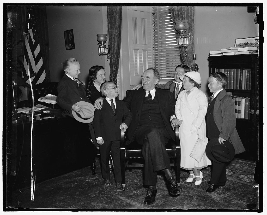 """No midget lap-sitting for Speaker Bankhead. Washington, D.C., April 30. """"Lap-sitting is out"""" Speaker Bankhead today as he greeted a troupe of circus midgets from his home state of Alabama [at the] Capitol. An enterprising photographer sought to repeat the J.P. Morgan act of a few years ago (?) the noted financier placed on the midgets on [his] lap at a Senate hearing. But it was no go today as the Speaker was concerned, 4/30/37"""